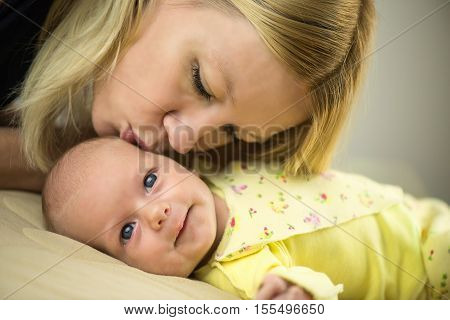 Mother and Baby kissing and hugging. Happy Family