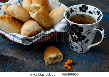 Russian pies with meat, cabbage and apples and hot tea