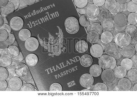 Black And White Thai Passport On A Pile Of Coins.
