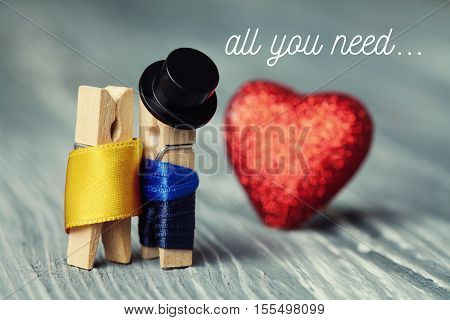 All you need is love invitation card. Romantic clothespin characters. Gentleman in black hat and woman in gold dress red heart background. Creative design retro style postcard.