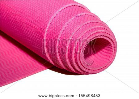 Rolled pink fitness or yoga mat on white background