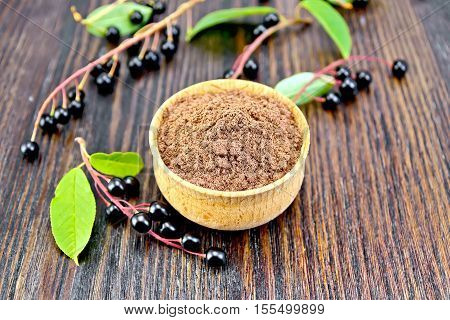 Flour Bird Cherry In Bowl With Berries And Leaves On Board