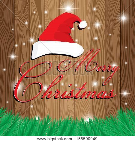 Merry Christmas and Santa's cap on wooden background. Christmas tree on Lath boards background.