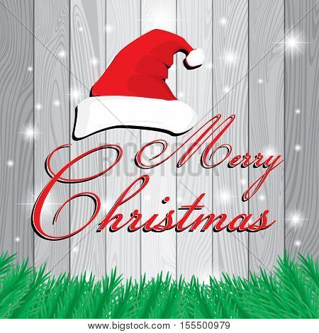 Merry Christmas and Santa's cap on white and grey wooden background. Christmas tree on grey Lath boards background.