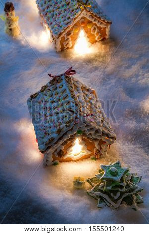 Gingerbread Cottage With Snow And Christmas Tree