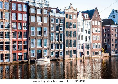"""AMSTERDAM, NETHERLANDS - OCTOBER 24, 2016: Beautiful views of the streets, ancient buildings, people, embankments of Amsterdam - also call """"Venice in the North"""". Netherland"""