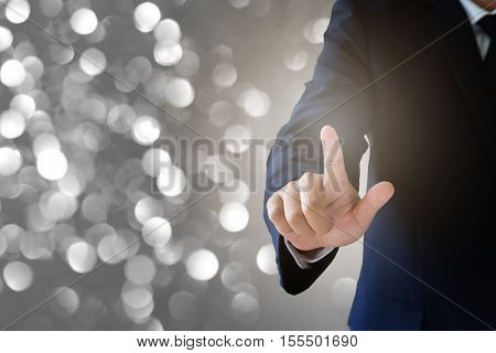 Business Concept, Businessman Touching Visual Screen With Blurred Light Background
