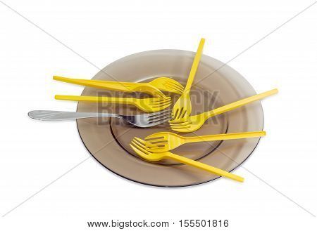 Several yellow plastic disposable forks and one stainless steel fork on a dark glass dish on a light background