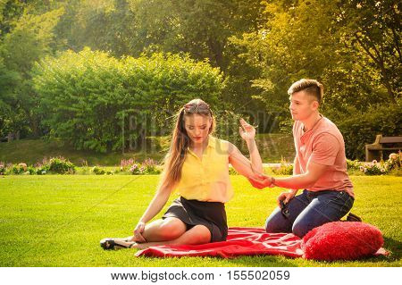 Couple With Big Heart On Picnic