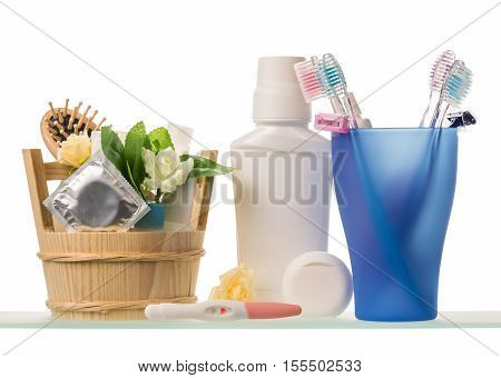 Tooth brushes, razors, lotion, toothpaste and deodorant isolated on white background.