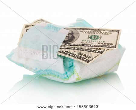 Disposable diaper and money close up isolated on white background.