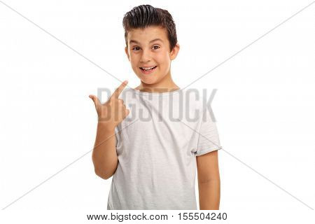 Little boy pointing at his smile isolated on white background