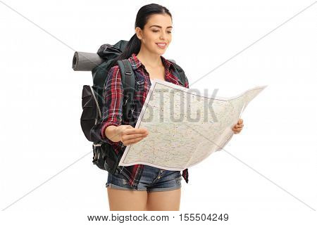 Female hiker looking at a generic map isolated on white background