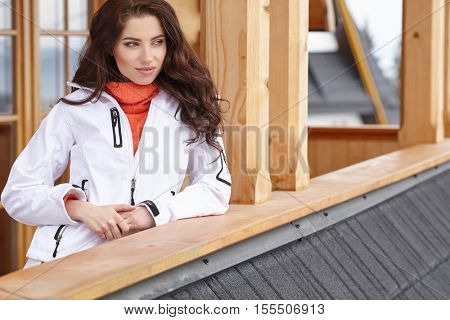woman with cup of hot chocolate on mountain ski resort.
