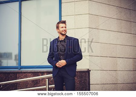 Handsome young businessman portrait outdoor. copy space