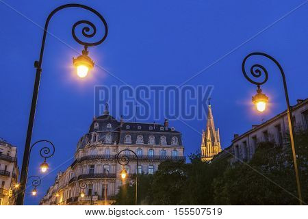 Montpellier street lamps and St. Anne Church in the background. Montpellier Occitanie France.