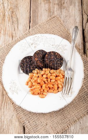 british breakfast with black pudding and baked bean on a plate