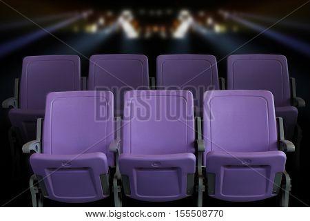 Empty theater auditorium or cinema with purple seats