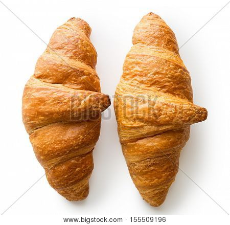 Two tasty buttery croissants isolated on white background.