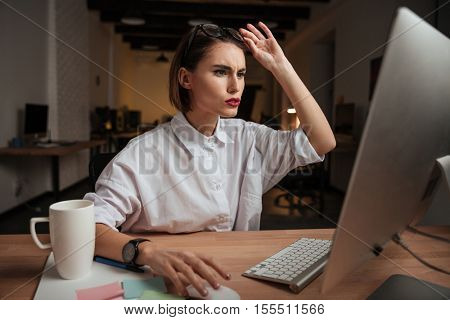 Thoughtful business woman in office