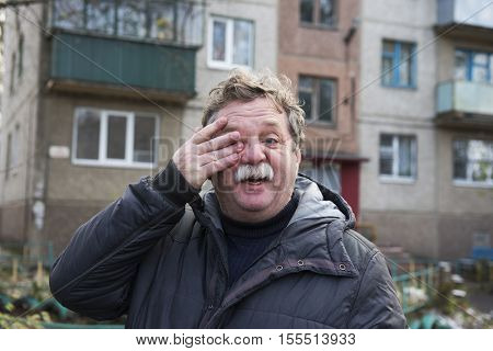 Portrait of a mature man with a mustache. Street photography