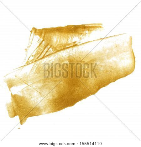 Golden paint stain isolated on white background. Shiny gold texture made with palette knife.