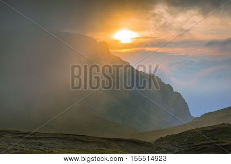 Picturesque Sunrise In The Bucegi Mountains From The Carpathians, Romania. The Sun Rises From Behind