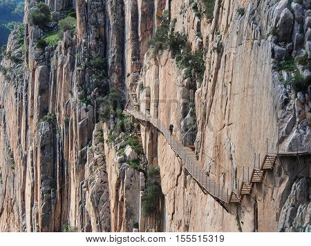 Mountain path along steep cliffs and an enormous heights