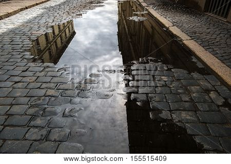 St. Petersburg,ancient pavement with reflection in water