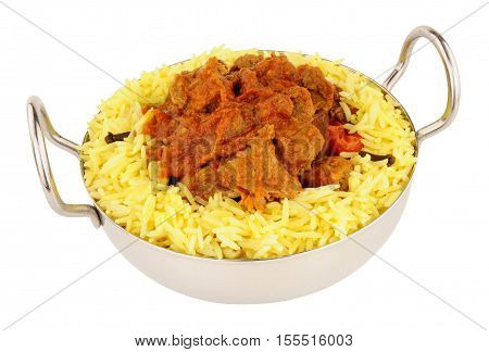 Lamb rogan josh meal with pilau rice isolated on a white background
