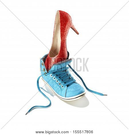 Classic stiletto high heels shoe in a red snake-print design put in a blue sport shoe