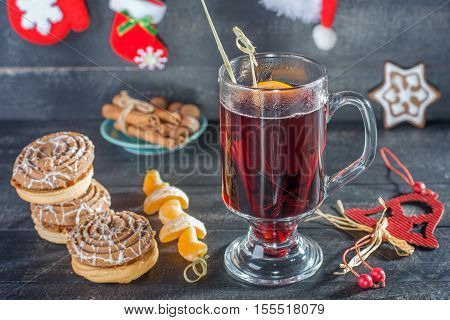 Mulled wine cookies and tangerin. Christmas background.