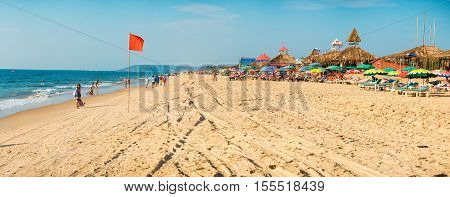 GOA, India - November 5, 2016: Panorama of the beach with tourists Calangute