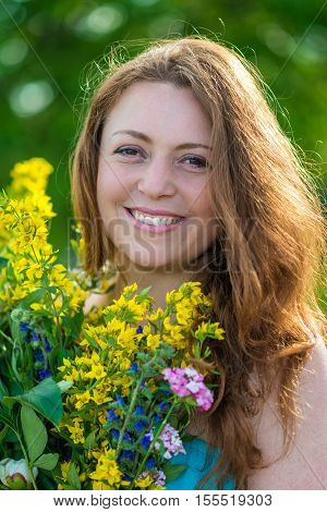 Portrait of a smiling girl with flowers