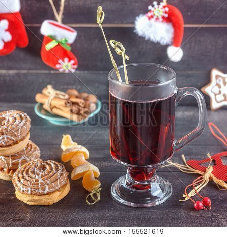 Mulled wine cookies and tangerines and cinnamon. Christmas background.