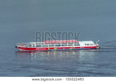 Stockholm Sweden - March 30 2016: Red sightseeing ship transports passengers and tourists in Stockholm Sweden. Sightseeing on Stockholm water.