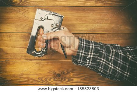 One stapler in man's hand