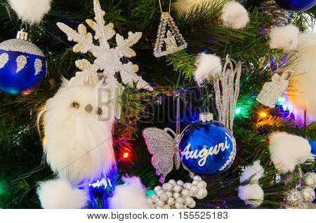 Christmas tree with decorations white and blue