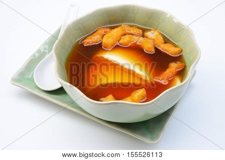 Bean junket eaten hot with gingered syrup, Soy custard