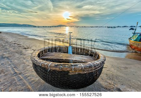 Basket boat before dawn as the sun slowly rise to express the rest of the season when fishermen fish on, languish waiting to be put to sea