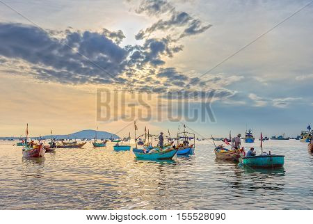 Phan Thiet, Vietnam - July 26th, 2016: Pier fishing at Mui Ne beach in the morning when the fishermen prepare for a trip out to sea full of fish caught