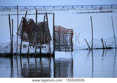 net of fisherman in the sea on sunset time in the countryside