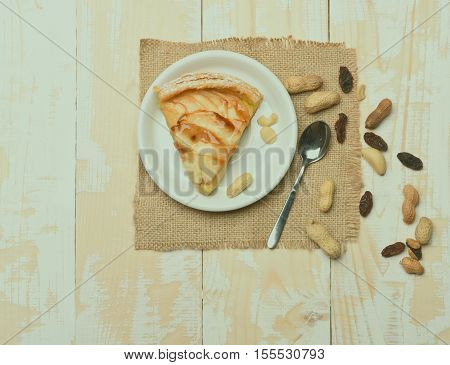 Slice Of Apple Pie On Vintage Wooden Background