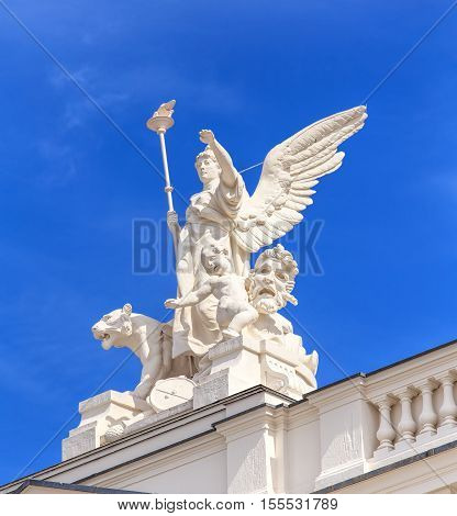 Zurich, Switzerland - 25 May, 2016: sculpture on the top of the Zurich Opera House building. Zurich Opera House has been the home of the Zurich Opera since 1891. It also houses the Bernhard-Theater Zurich and the Zurich Ballet.