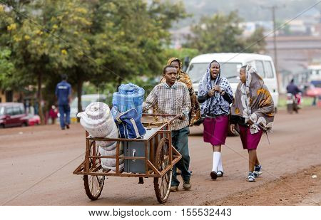 AFRICA, TANZANIA, MAY, 09, 2016 - Typical street scene in Arusha. Mostly a wheelbarrow is the only means of transportation of luggage. Arusha is located below Mount Meru in the eastern branch of the Great Rift Valley