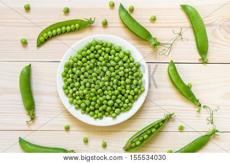Green Pea In Bowl Of Top View On Rustic Wooden Background With C