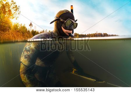 Man with spear gun going to hunt in the fresh water lake