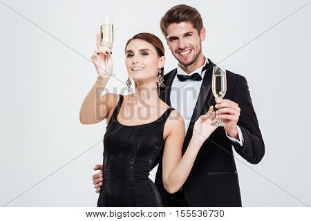 Beauty business people. with champagne. looking at camera