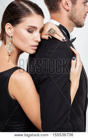 Beauty business couple. hugs from behind
