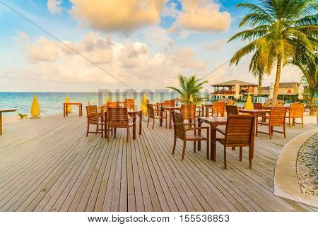 Table and chairs at restaurant in tropical Maldives island